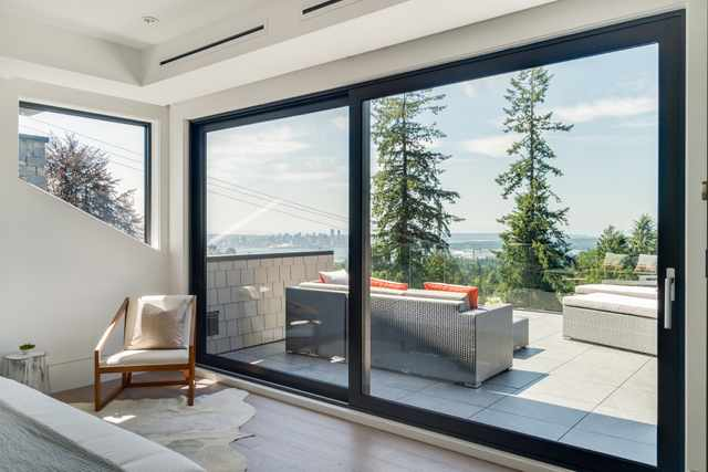 Bedroom with large sliding glass door and view.